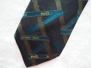 Hermes 100% Silk Tie -- Hermes Gift Ribbon design in Teal and Gold on Black