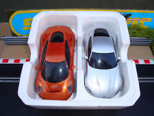 PAIR MINT COMPLETE UNBOXED SCALEXTRIC 007 ASTON MARTIN DB10 & JAGUAR C-X75 CARS.