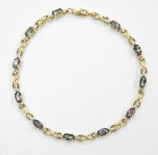 """7 1/8"""" 10k Gold Mystic Fire Topaz and Diamond Bracelet"""
