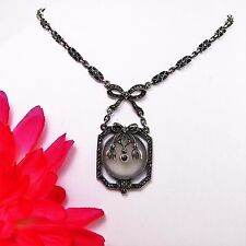 Antique pendant sterling silver Art Deco with rhodolite, marcasites & crystal