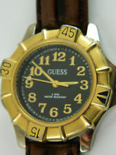 GUESS  BLACK FACE GOLD TONE NUMERAL /2 TONE BEZEL /LEATHER BAND