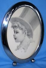 "ANTIQUE OVAL SILVER FRAME TABLE TOP w/PRINT OF YOUNG CHILD 12""H x 9""W x 1 1/4""D"