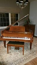 schafer and sons baby grand piano polished mahagony. Includes bench