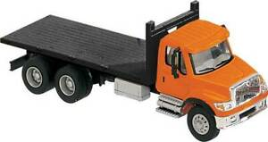 Walthers HO Scale International 7600 3-Axle Flatbed Truck Orange Cab/Black Bed