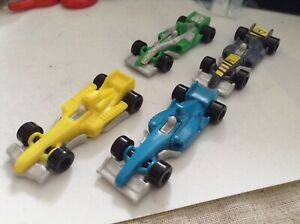 4 X plastic F1 racing cars kinder sprinty 2 and half inches maybe HO 1/87