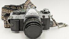 Canon AE-1 Program 35mm Film Camera w/ Canon 50mm Lens FD 1:1.8 Strap & Grip