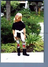 FOUND COLOR PHOTO L_9786 GIRL IN BOOTS STANDING BY PLANTS