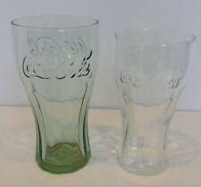 Coca Cola Glasses. Coca Cola Label. One Green-One Clear.