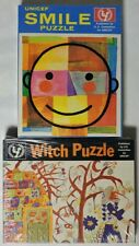 ESAR3684. VINTAGE: Lot of 2: UNICEF SEALED PUZZLES featuring SMILE & WITCH