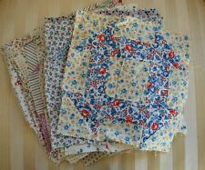 VINTAGE CHEERFUL PRINTED COTTON FLORAL QUILT BLOCKS CIRCA 1930 HAND SEWN 29 PCS.