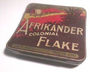 RARE WW1  VINTAGE COHEN WEENEN AFRIKANDER COLONIAL FLAKE CURVED TOBACCO TIN