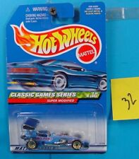 C32 HOT WHEELS CLASSIC GAMES SERIES SUPER MODIFIED #981 BLUE/GRAPHIC NEW ON CARD