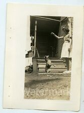 1950s  amateur snapshot  Photo Teen Girl with dog on hind legs