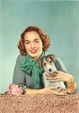 Beauty lady with terrier puppy dog semi-modern postcard