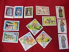 13 postage Stamps from Mongolia (Native Dress; Camels; Horses; Temples)