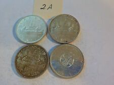 FOUR    CANADIAN      SILVER     DOLLARS      2  A
