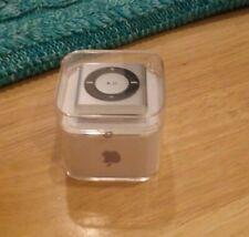 Apple iPod shuffle 2GB, 4th Generation, Silver color, in a box.