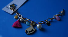 colourful bracelet with wooden rocking horse