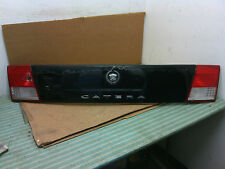 2000 - 2001 Cadillac Catera rear tail light license plate finish panel OEM black