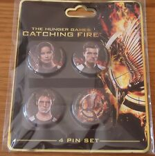 THE HUNGER GAMES MOVIE : CATCHING FIRE COLLECTABLE BADGES.
