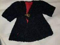 "ANTIQUE BLACK WOOL DOLL COAT WITH RED LINING ABOUT 6"" WIDE WAIST 10.25"" LENGTH"