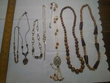 Vintage lot of 7 costume jewelry necklaces.beads, stone, wood beads, brown tones