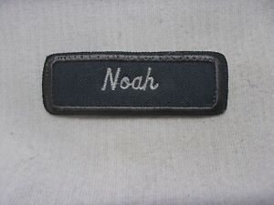 NOAH USED EMBROIDERED VINTAGE SEW ON NAME PATCH TAGS GREY ON WHITE 1 X 3