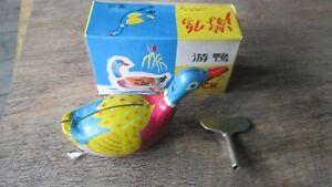 Ancien jouet-Canard métal,fer  blanc-Clé remontoir-Fonctionne-boite d origine