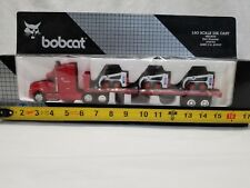 1/50 scale Bobcat Flat Bed Trailer with 3 753 Skid Steer Loaders