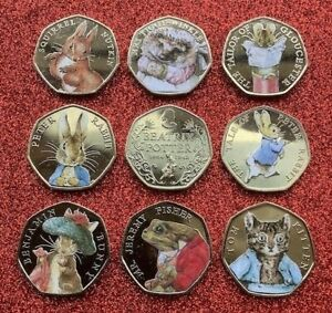 SET OF 9  BEATRIX POTTER 50P COINS IN CAPSULES AND GIFT BAGS + A FREE GIFT