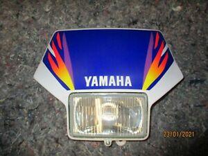 plaque phare et optique complet quasi neuf ( démonté à l'achat ) YAMAHA 250 TTR