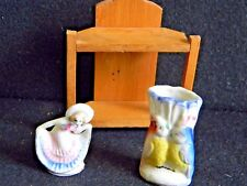 Japan Pottery- 1 small parrot vase and 1 small dancing figure with wood stand.