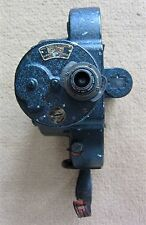 BELL & HOWELL 1920'S MOVIE CAMERA. TAYLOR HOBSON LENS. FILM REELS INCLUDED
