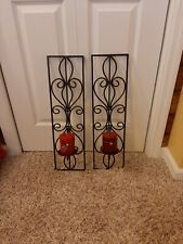 2 black wrought iron wall mount candle holders