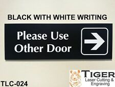 PLEASE USE OTHER DOOR WITH RIGHT ARROW GRAPHIC SIGN 20CM X 6.5CM - TLC-024