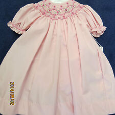 Petit ami bishop dress size 6mo.pink with smocking,new w/tags