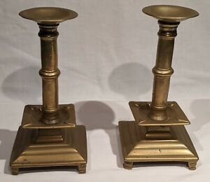Two 18th or early 19th Century Russian Brass Candleticks on Square Footed Bases