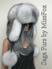 Scandinavian blue fox trapper hat.With pompons