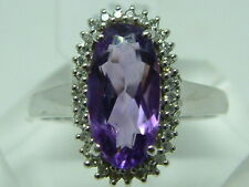 9CT WHITE GOLD OVAL AMETHYST AND DIAMONDS CLUSTER RING