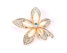 Gold Tone Flower Brooch with Pearlescent Stone and Clear Rhinestones