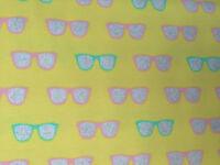 """Elast. Baumwoll-Jersey  """"Glitzer-Brillen"""", gelb, 150 cm br., Meterw., €11,00/qm"""