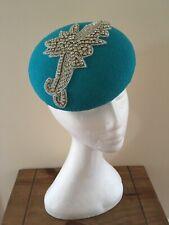 Bright blue pillbox hat with rhinestone detail
