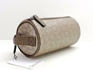 Calvin Klein Cylinder Cosmetic Bag Case Makeup Travel Champagne Metallic New!