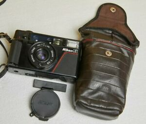 NIKON L35AF 35mm film camera with flash case and caps - working and tested