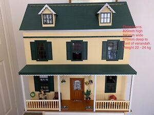 Wooden Doll house plus furniture, accessories and lighting (not toy)