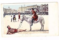 MAN ON BEACH WOMAN ON DONKEY--OH-COME OFF--- POSTCARD