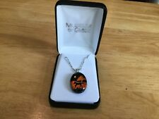 Silver Necklace with Orange and Black Glass Cantering Horse Pendant