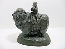 Vintage Cast Iron Boy Blowing Horn on Woolly Sheep Ram Statue