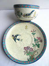 French Majolica cup and saucer, Longwy enamels with Bird and Flowers