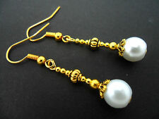 A PAIR GOLD PLATED DANGLY WHITE GLASS PEARL EARRINGS. NEW.